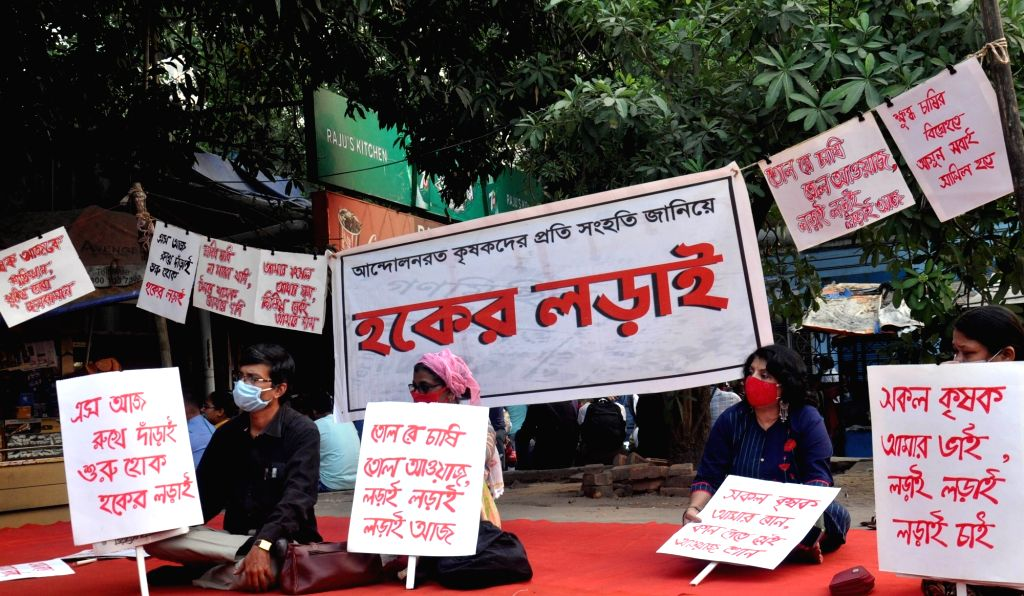 Activists of Renu Chaya Mukta Mancha hold a protest against the three new contentious farm laws, in Kolkata on Dec 4, 2020.