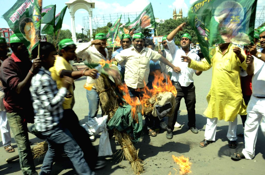 Activists of RJD youth wing stage a demonstration against Prime Minister Narendra Modi's tenure in Patna on Sept 4, 2014. - Narendra Modi