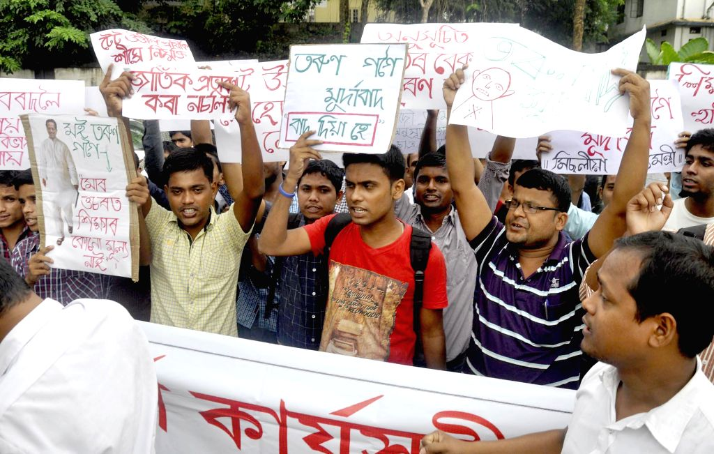 Activists of Sadou Asom Anususit Jati Satra Santha (SAAJSS) stage a demonstration to press for speedy recruitment of Teacher Eligibility Test (TET) qualified candidates in Guwahati on Sept 5, 2014.