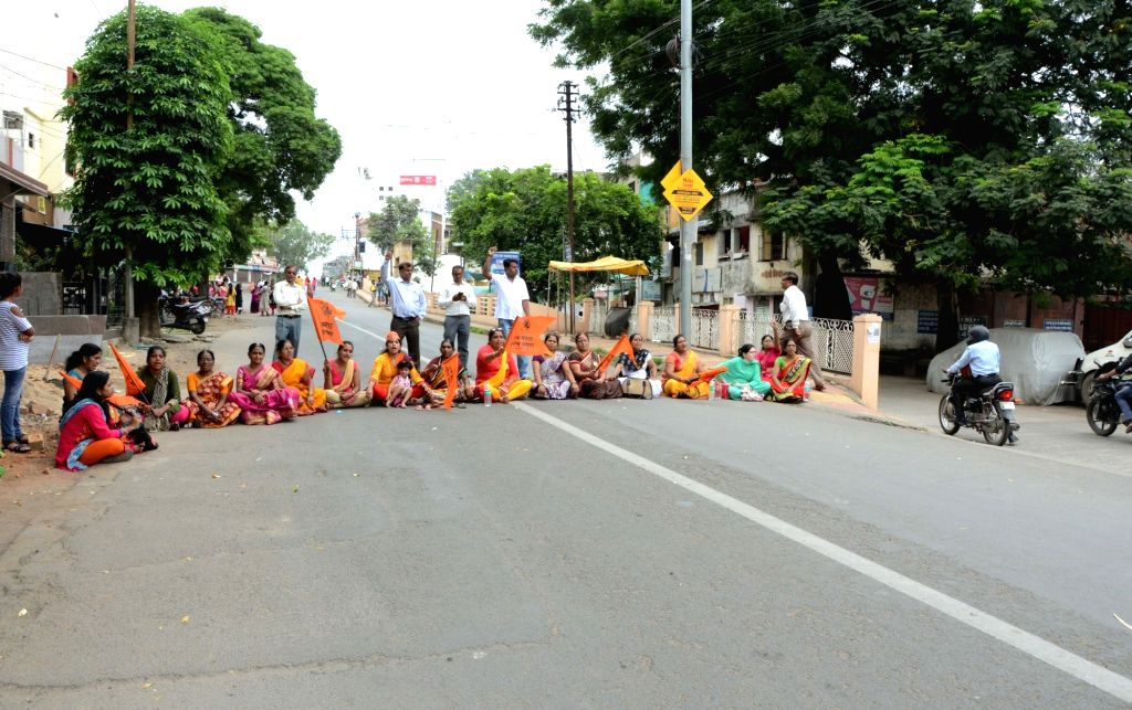 """Activists of Sakal Maratha Samaj and Maratha Kranti Morcha participate in """"Rasta Roko Andolan"""" as they block streets to press for employment and education quotas during ..."""
