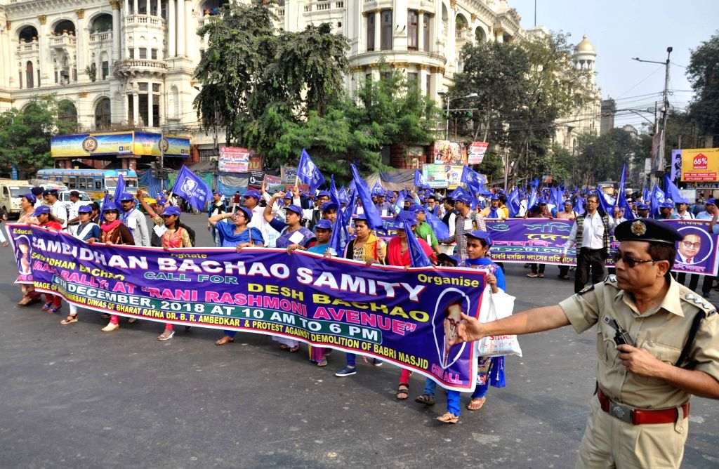 Activists of 'Samvidhan Bachao Samiti' participate in a rally organised on Dalit icon B. R. Ambedkar's death anniversary in Kolkata, on Dec 6, 2018.