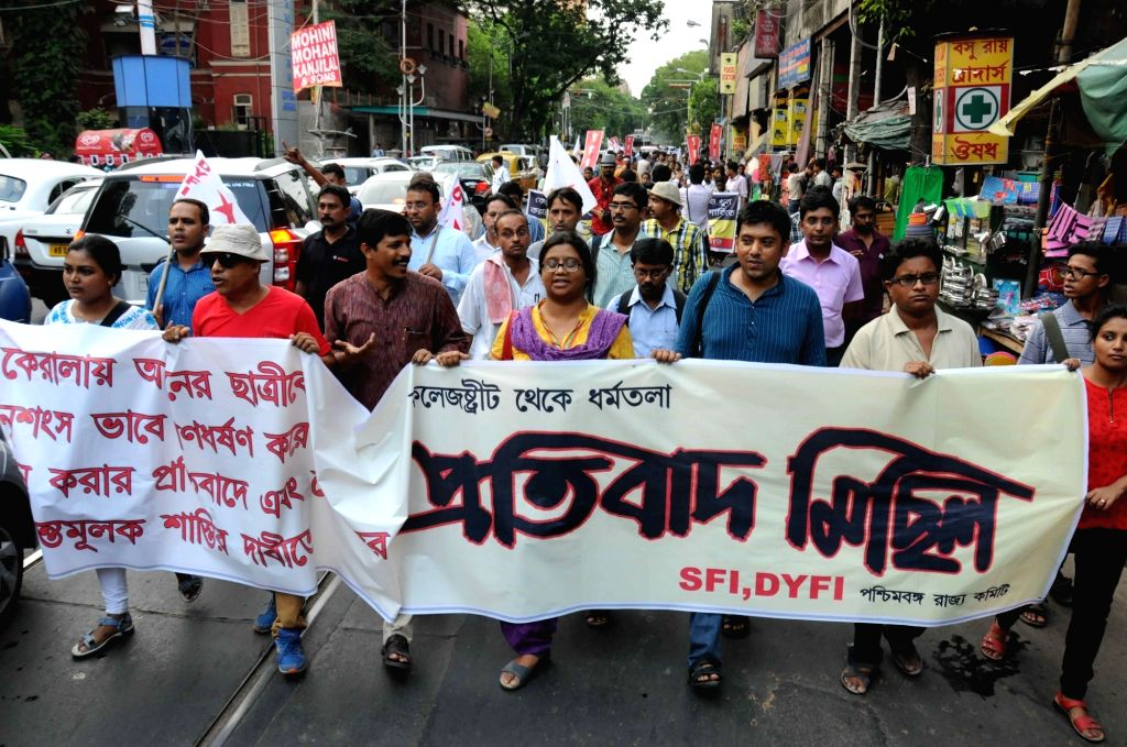 Activists of SFI and DYFI participate in a protest rally against Dalit woman's murder in Kerala; in Kolkata, on May 6, 2016.