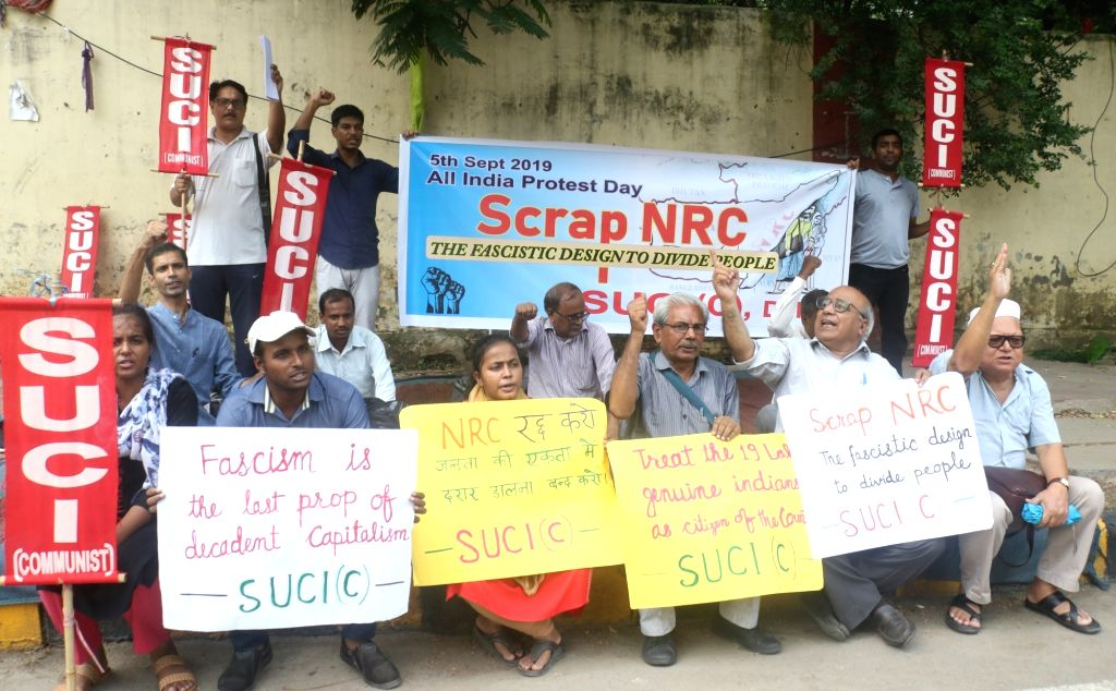 Activists of Socialist Unity Centre of India - Communist (SUCI-C) stage a demonstration demanding to scrap National Register of Citizens (NRC) in Assam; in New Delhi on Sep 5, 2019.