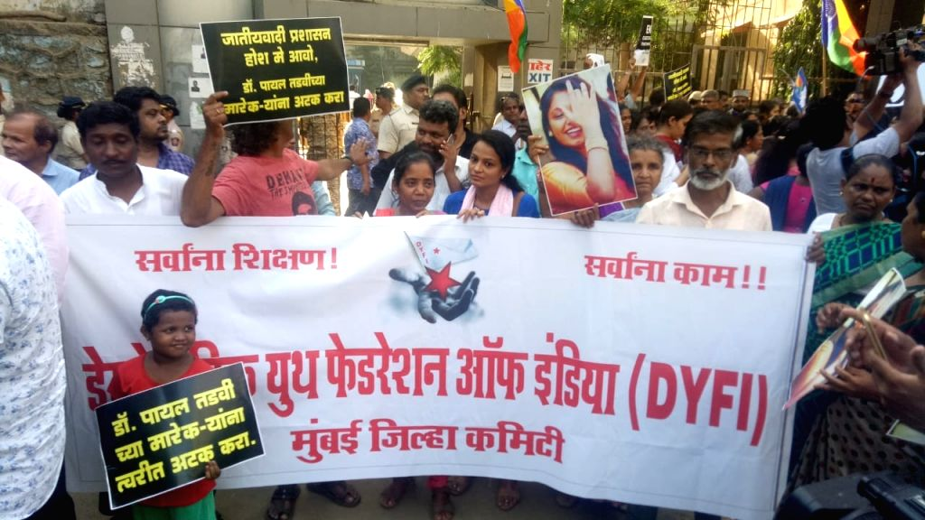 Activists of Students Federation of India (SFI) and other student organisations stage a demonstration against the recent suicide of a post-graduate woman medical student due to alleged ...