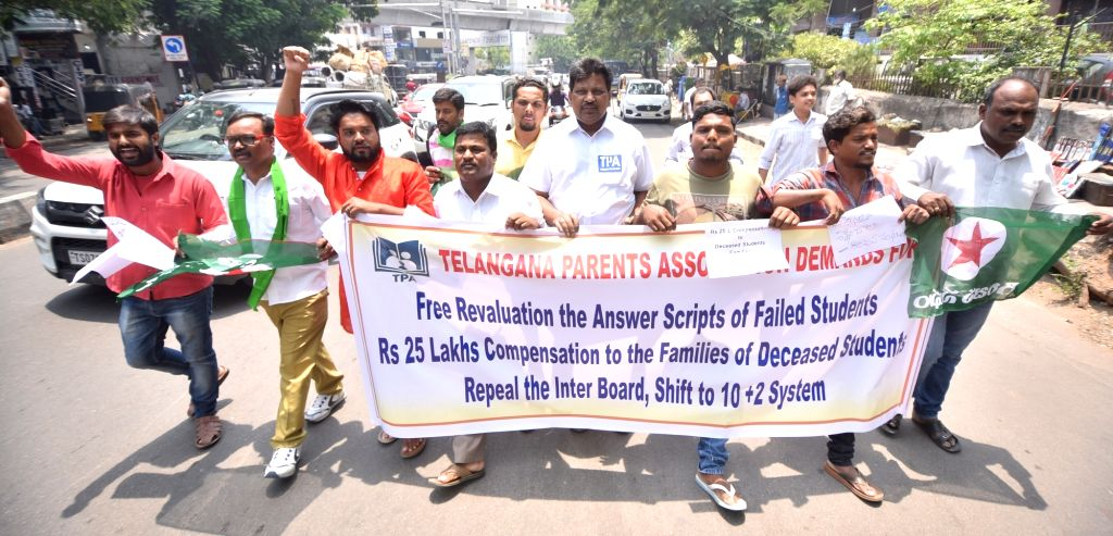 Activists of Telangana Parents Association (TGPA) stage a demonstration against the Telangana State Board of Intermediate Education (TSBIE) over the alleged fudging of results, in ...