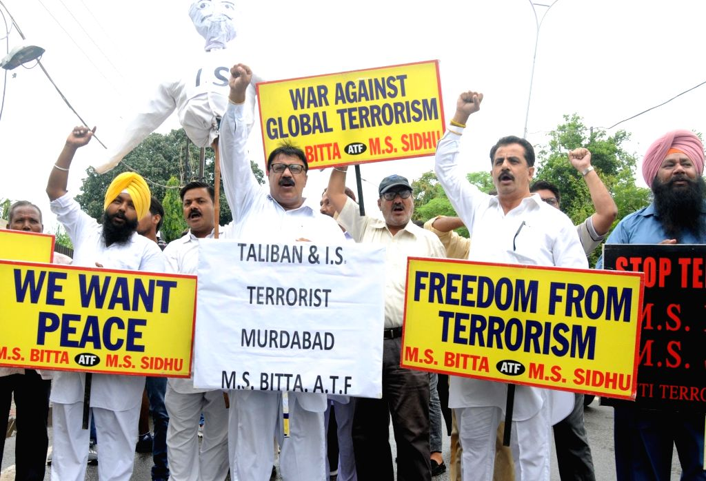 Activists of the All India Anti-Terrorist Front (AIATF) stage a demonstration against the suicide bombing that claimed the lives of 19 people, including Sikhs and Hindus in Afghanistan's ...