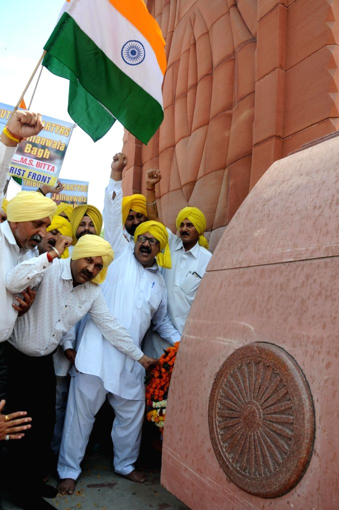 Activists of the All-India Anti-Terrorist Front (AIATF) pay tributes to the martyrs of 1919 Jallianwala Bagh massacre ahead of the 100th anniversary of the massacre, in Amritsar on April ...