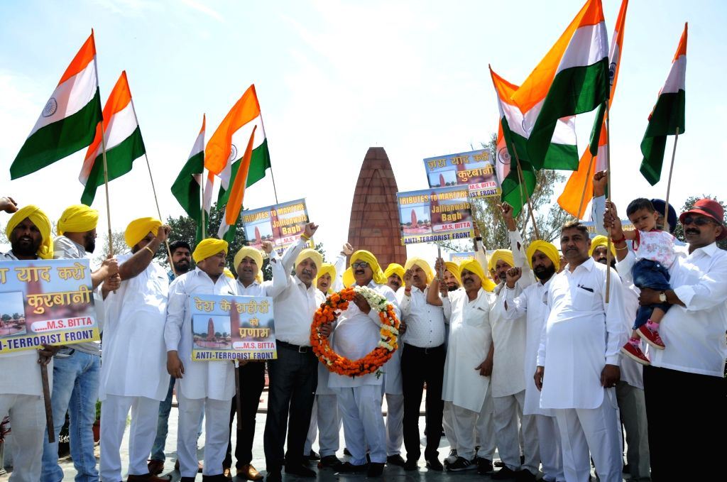 Activists of the All-India Anti-Terrorist Front (AIATF) participate in a rally to pay tributes to the martyrs of 1919 JallianwalaBagh massacre ahead of the 100th anniversary of the ...