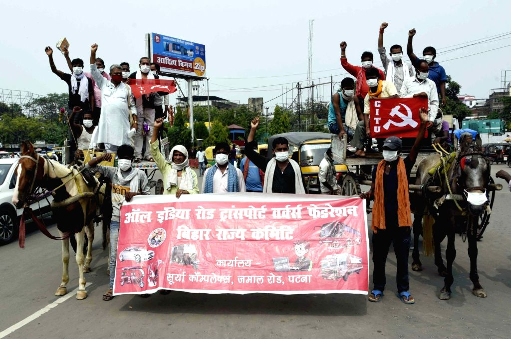 Activists of the All India Road Transport Workers Federation stage a demonstration against hike in the prices of petrol and diesel, in Patna  July 3, 2020.
