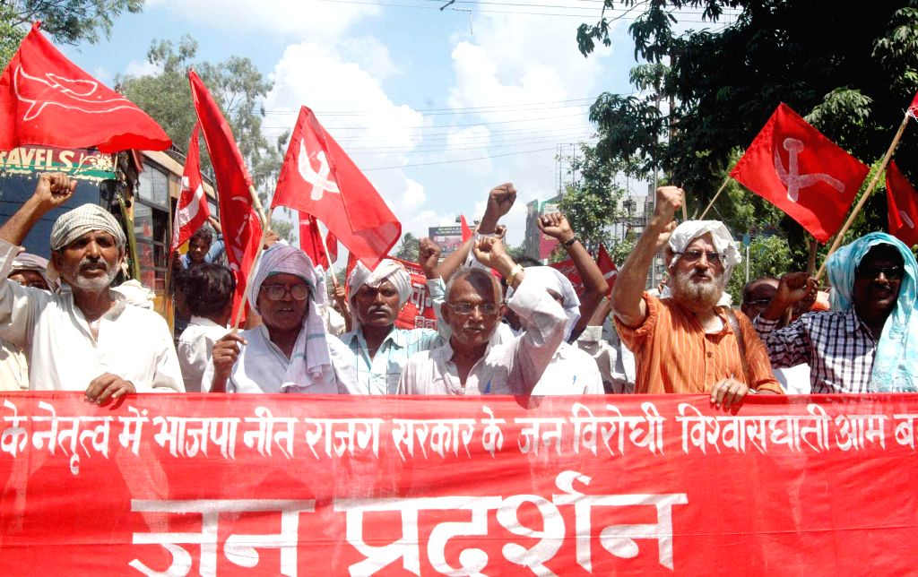 Activists of the CPI (ML) staged a demonstration against Narendra Modi government in Patna on July 26, 2014.