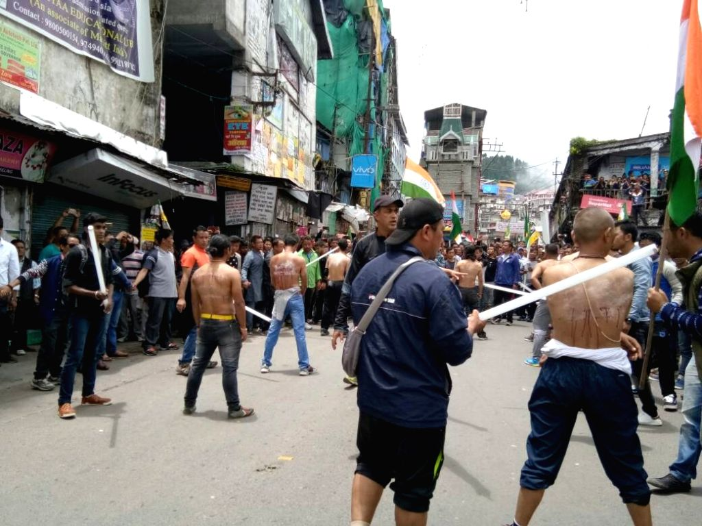 "Activists of the Yuva Morcha - the youth wing of the GJM  a ""tubelight rally"" and broke the tubelight rods on their back to protest against state government and police action in ..."