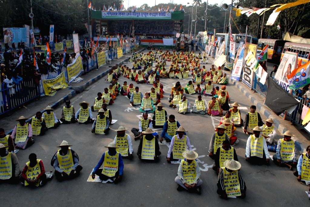 Activists of TMC Khet Mazdoor Union stage a sit-in demonstration against the Citizenship Amendment Act (CAA) 2019, National Register of Citizens (NRC) and National Population Register (NPR), ...