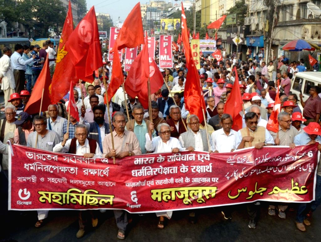 Activists of various Leftist organisations led by Left Front chairman Biman Bose and CPI-M leader Surjya Kanta Mishra, participate in a rally on the 26th anniversary of Babri Masjid ... - Biman Bose and Surjya Kanta Mishra