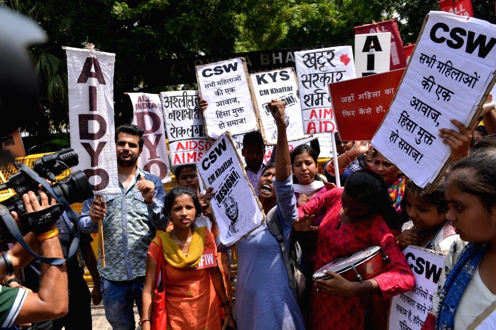 Activists of various organisation stage a demonstration to protest against brutal Rewari gang-rape; in New Delhi, on Sept 17, 2018.