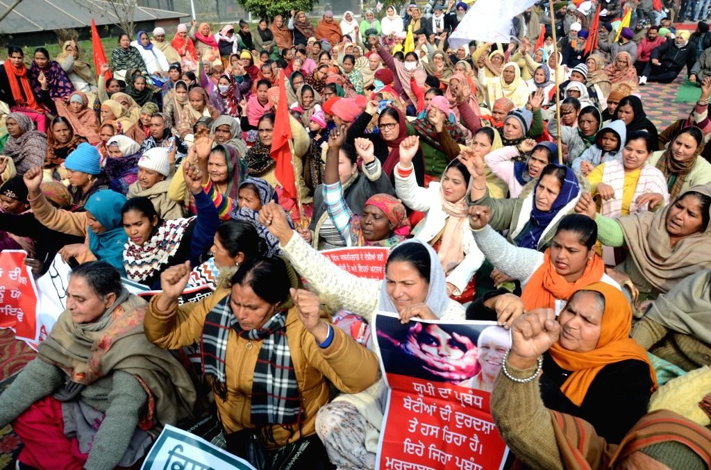 Activists of various organisations take part in a demonstration held in support of farmers who are continuing their protest against the central government's recent agricultural reforms in ...