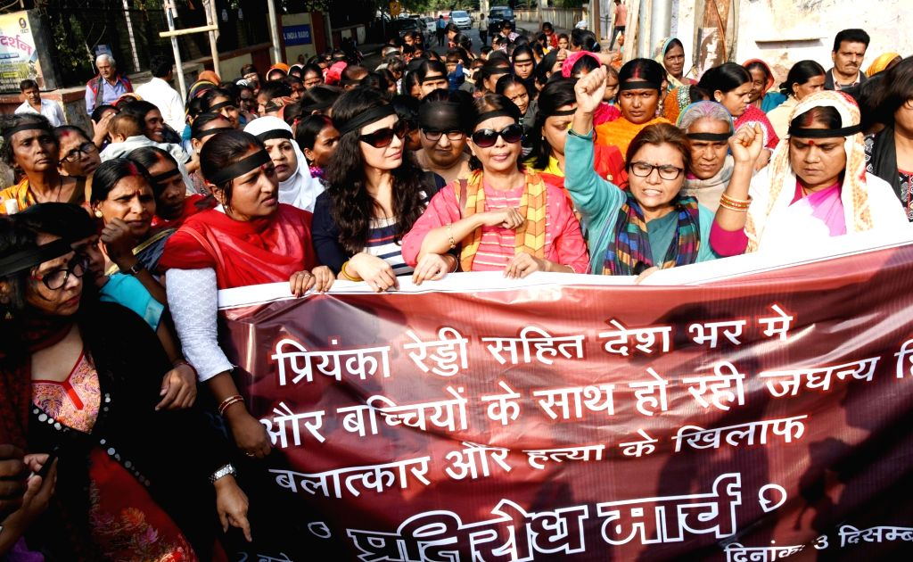 Activists of various social women groups participate in a protest march condemning the gruesome gang rape and murder of a woman veterinarian in Hyderabad; in Patna on Dec 3, 2019.