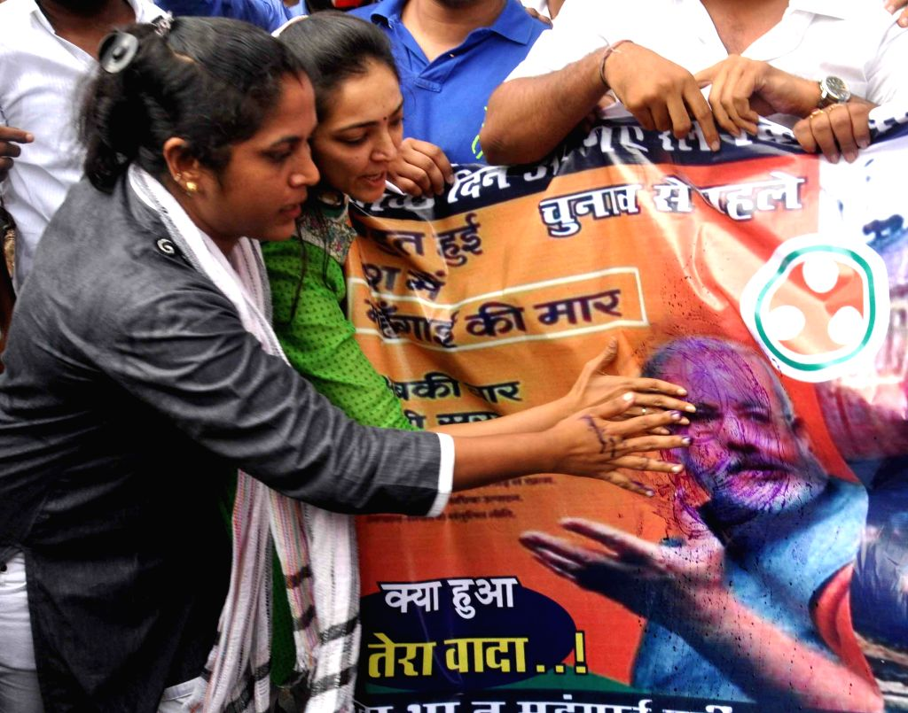 Activists of Youth Congress protest against the hike in rail fares and shout anti-government slogans at CST in Mumbai on June 21, 2014.