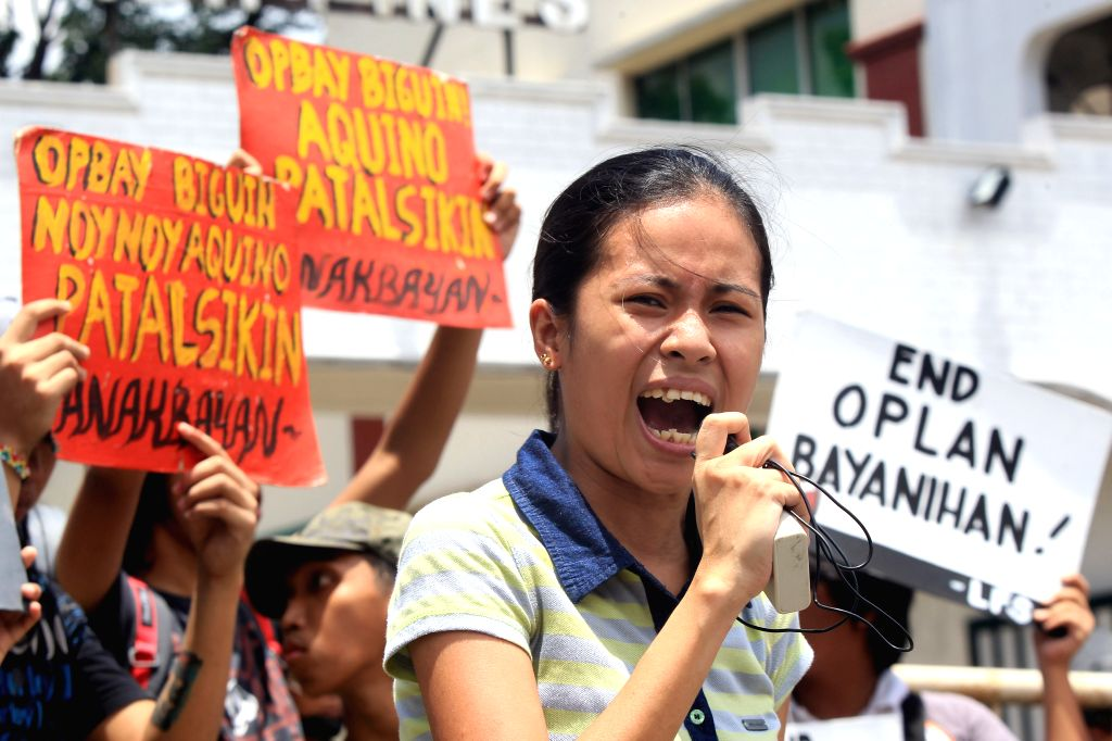Activists protest in front of the Armed Forces of the Philippines (AFP) headquarters in Quezon City, the Philippines, Aug. 11, 2015. The activists condemned the ...