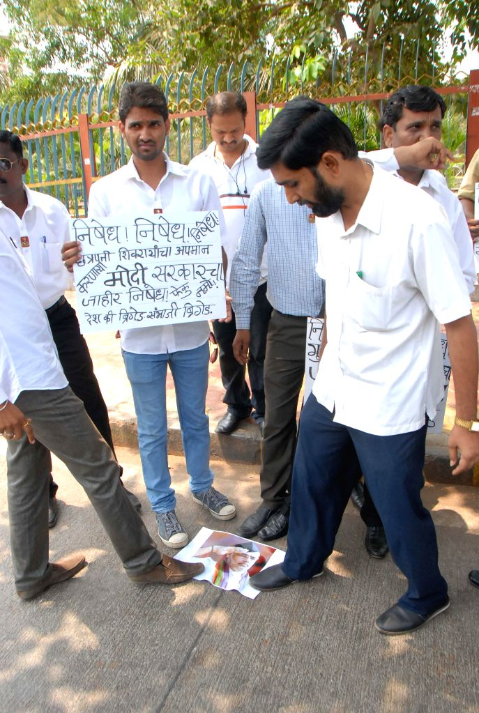 Activists protesting against the course curriculum on Chatrapati Shivaji Maharaj at schools of Gujarat in Mumbai on April 17, 2014.