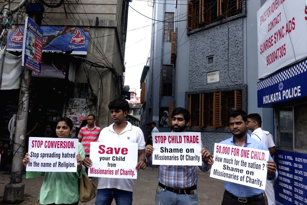 Activists stage a demonstration against the Missionaries of Charity, in Kolkata, on July 8, 2018. Two persons including a nun of the Missionaries of Charity established by Mother Teresa, ...