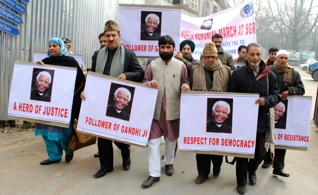 Activits of Gandhi Global Family paying tribute to Nelson Mandela during a march in Srinagar on Dec. 14, 2013.