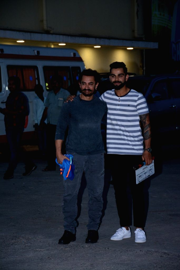 Actor Aamir Khan and Cricketer Virat Kohli during the shoot for a chat show in Mumbai on Oct 3, 2017. - Aamir Khan and Virat Kohli