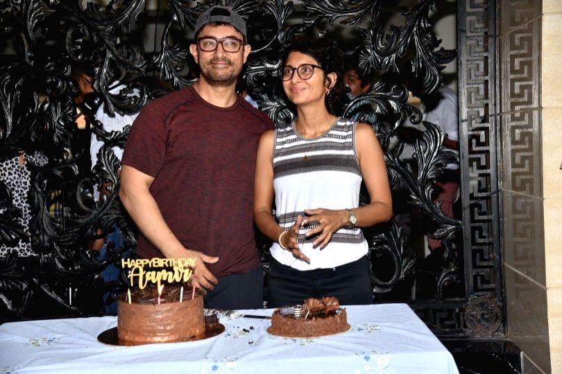 Actor Aamir Khan celebrates his birthday with his wife Kiran Rao in Mumbai, on March 14, 2019. - Aamir Khan and Kiran Rao
