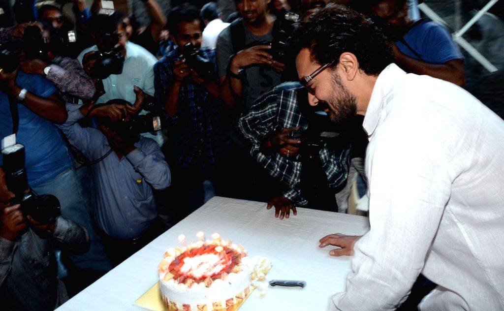 Actor Aamir Khan cuts a cake to celebrate his 52nd birthday in Mumbai on March 14, 2017. - Aamir Khan