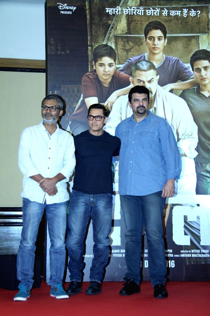 Actor Aamir Khan during the poster launch of his upcoming film 'Dangal' in Mumbai on July 4, 2016. - Aamir Khan