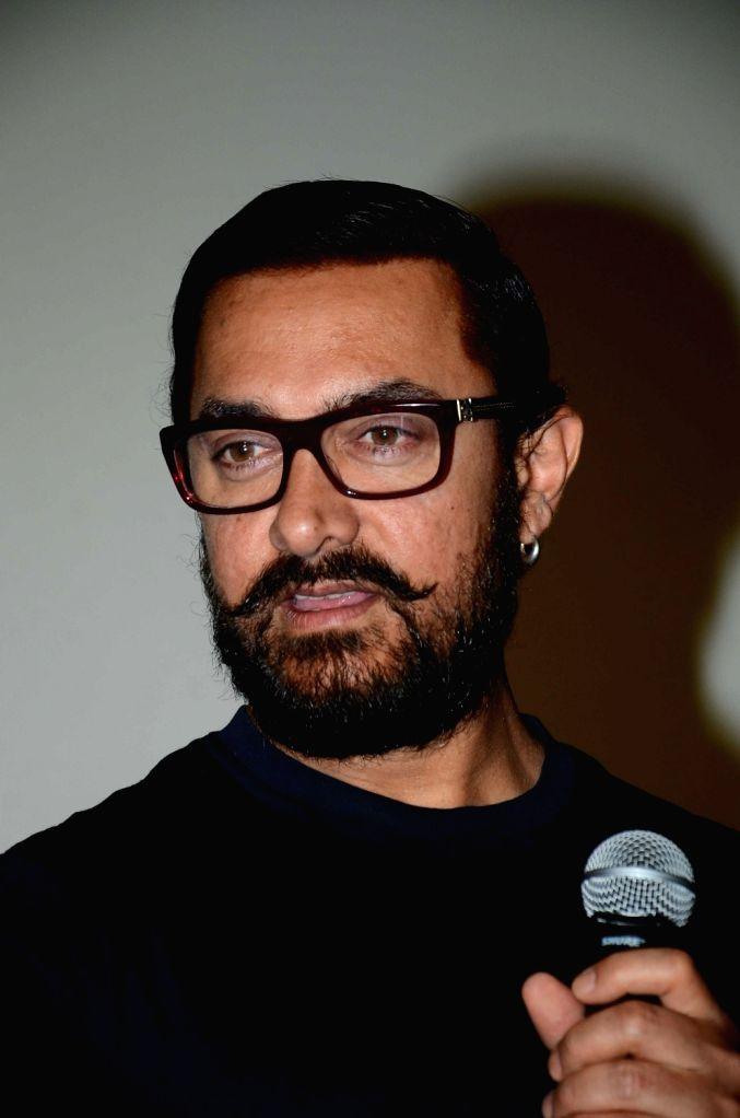 Actor Aamir Khan during the song launch of film Dangal in Mumbai, on Nov 12, 2016. - Aamir Khan