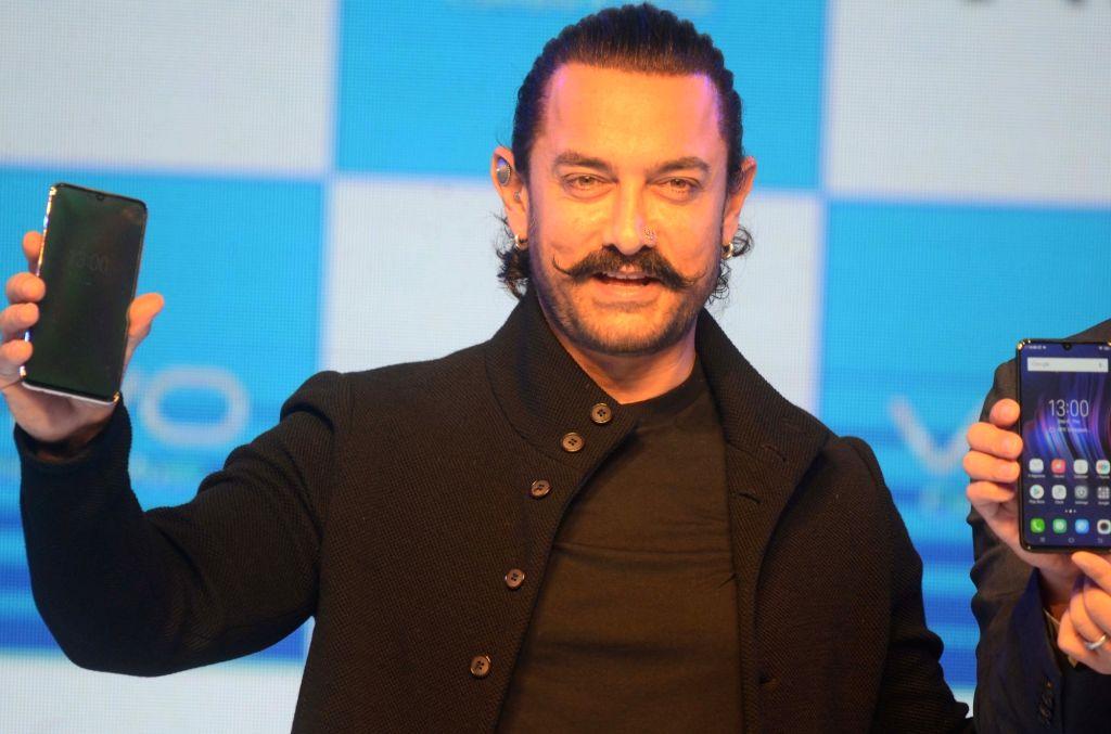 Actor Aamir Khan launches Vivo V11 Pro smartphone, in Mumbai, on Sept 6, 2018. - Aamir Khan