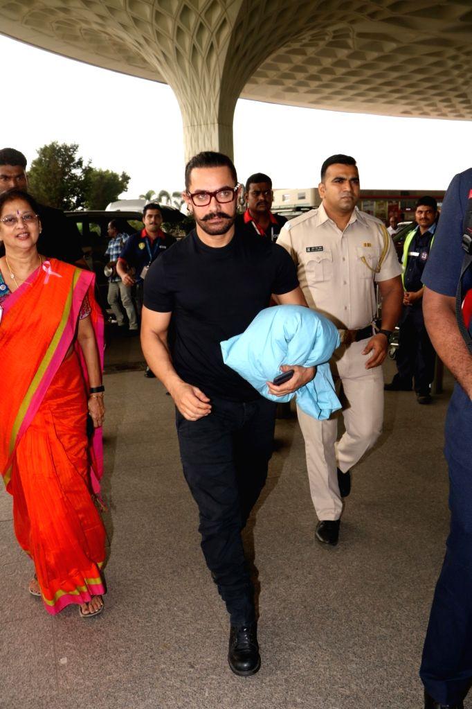 Actor Aamir Khan seen at Chhatrapati Shivaji Maharaj International airport in Mumbai. - Aamir Khan