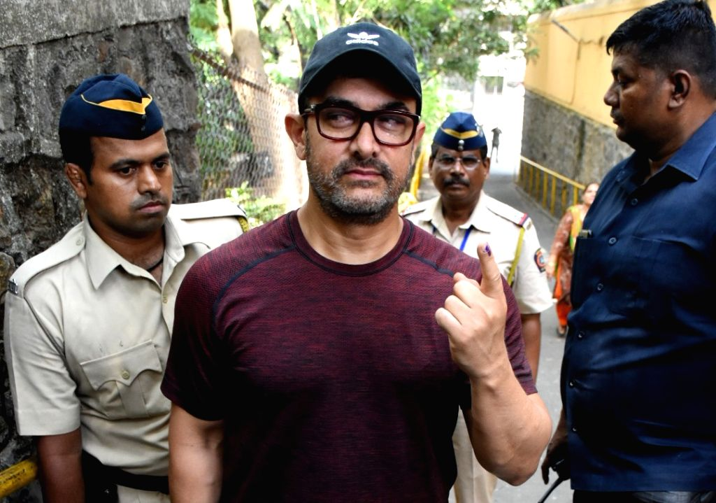 Actor Aamir Khan shows his forefinger marked with indelible ink after casting vote during the fourth phase of 2019 Lok Sabha elections in Mumbai on April 29, 2019. - Aamir Khan