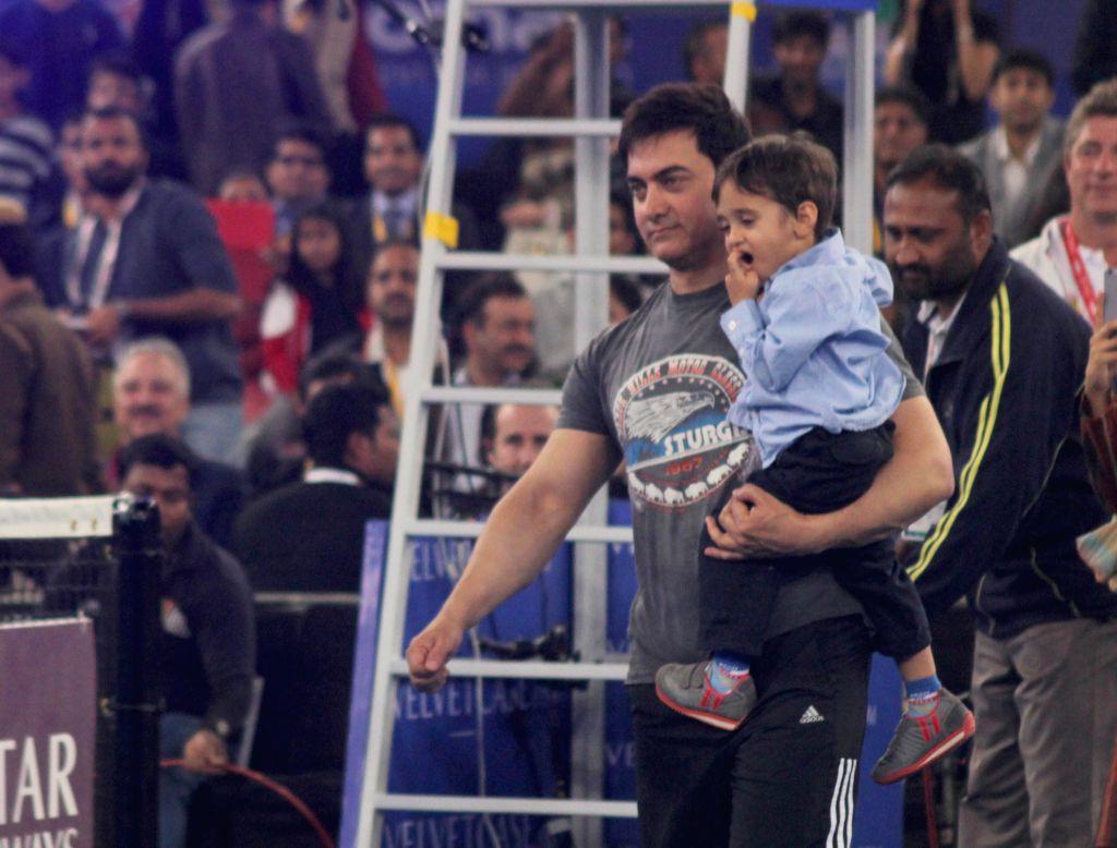 Actor Aamir Khan with his son during an IPTL match at Indira Gandhi Indoor Arena in New Delhi, on Dec 8, 2014.