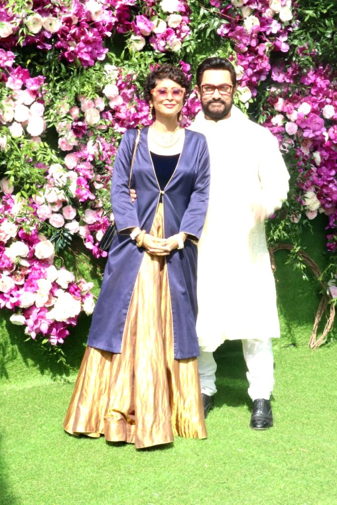 Actor Aamir Khan with his wife, filmmaker Kiran Rao at the wedding festivities of Akash Ambani and Shloka Mehta in Mumbai on March 9, 2019. - Aamir Khan, Kiran Rao, Akash Ambani and Shloka Mehta
