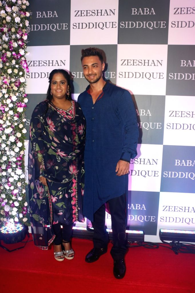 Actor Aayush Sharma and his wife Arpita Khan at Congress leader Baba Siddique's Iftar party in Mumbai, on June 2, 2019. - Aayush Sharma and Arpita Khan