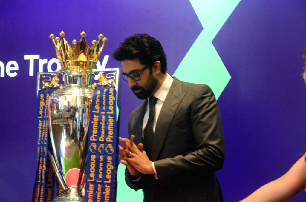 Actor Abhishek Bachchan with Football Premier League champions Trophy in Mumbai on March 2, 2017. - Abhishek Bachchan
