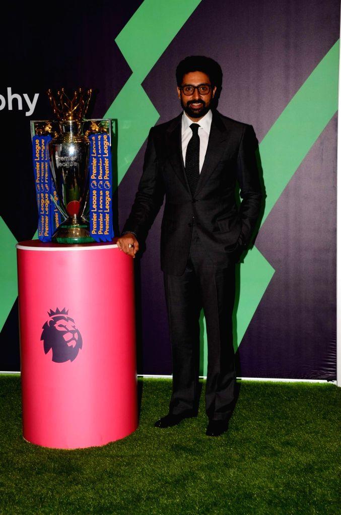 Actor Abhishek Bachchan with Football Premier League champions Trophy in Mumbai on March 2, 2017. - Abhishek Bachchan