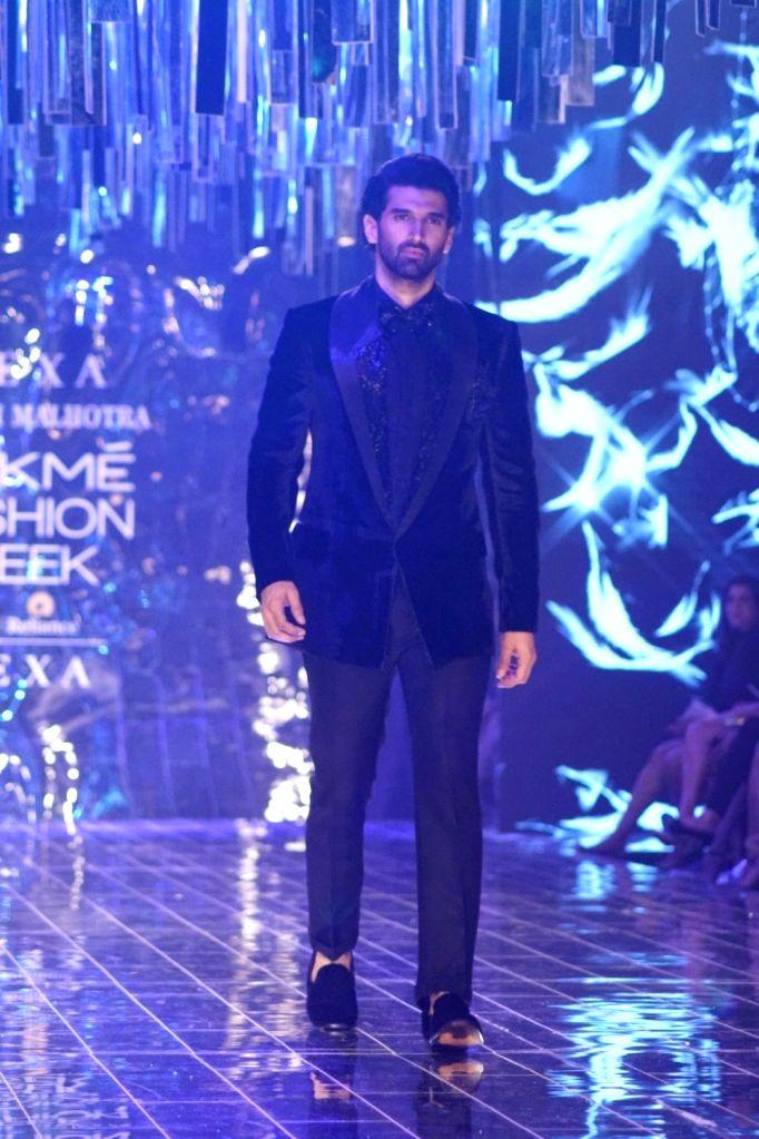 Actor Aditya Roy Kapur displays the creation of fashion designer Manish Malhotra during the Lakme Fashion Week Winter/Festive 2017 in Mumbai on Aug 20, 2017. - Aditya Roy Kapur and Manish Malhotra