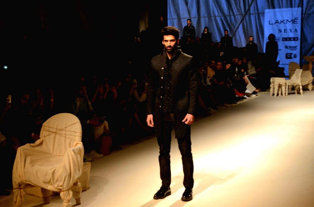 Actor Aditya Roy Kapur walks the ramp to showcase the creations of fashion designer Kunal Rawal at the Lakme Fashion Week (LFW) Summer/Resort 2019 in Mumbai on Feb 3, 2019. - Aditya Roy Kapur