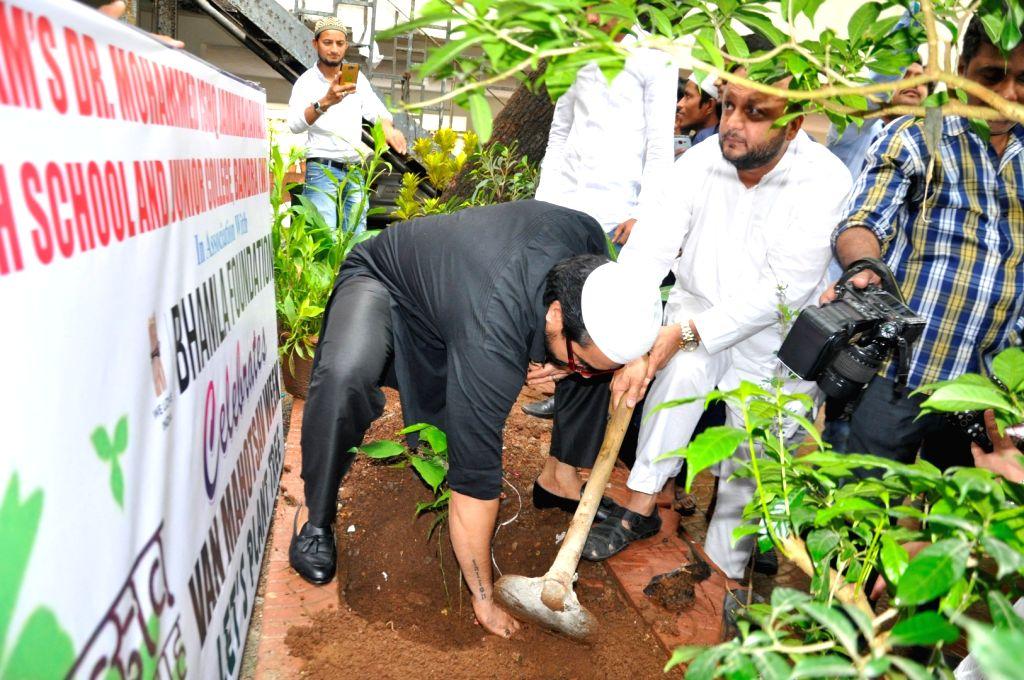 Actor Aijaz Khan during the tree plantation on the occasion Van Mahotsav Week at Anjuman-I-Islam Girls Gigh School, in Mumbai, on July 1, 2016. - Aijaz Khan