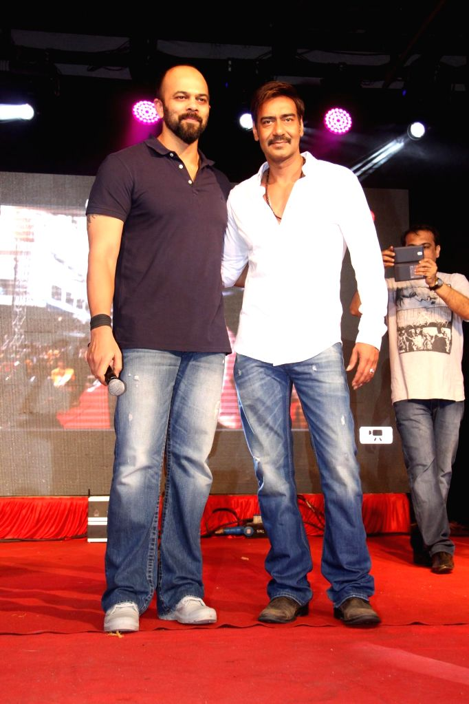 Actor Ajay Devgan and director Rohit Shetty during the promotion of the film Singham Returns at Umang Festival in Mithibai College, Mumbai on Aug 14, 2014. - Ajay Devgan and Rohit Shetty