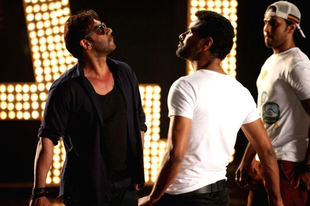 Actor Ajay Devgan and Indian film actor, director and dance choreographer Prabhu Deva on the sets of their upcoming film `Action Jackson`. - Ajay Devgan