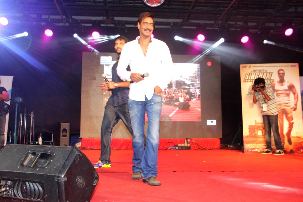 Actor Ajay Devgan during the promotion of the film Singham Returns at Umang Festival in Mithibai College, Mumbai on Aug 14, 2014. - Ajay Devgan