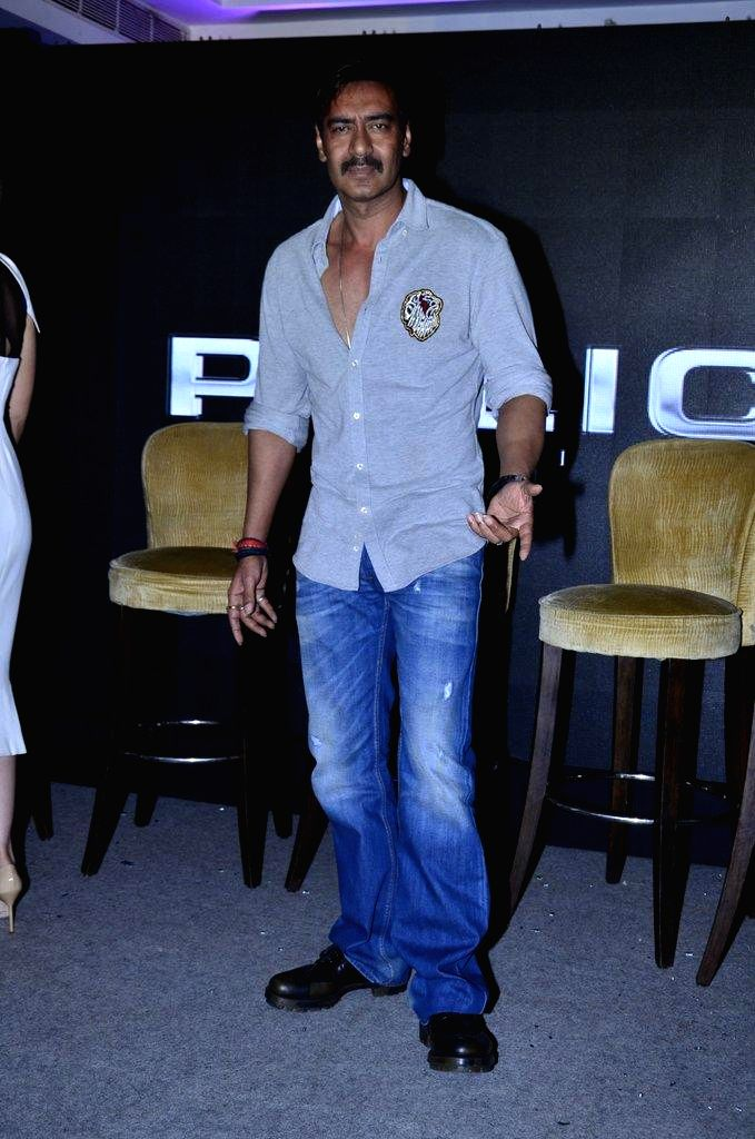 Actor Ajay Devgn during the launch of Singham time wear collection by Police in Mumbai, on August 9, 2014. - Ajay Devgn