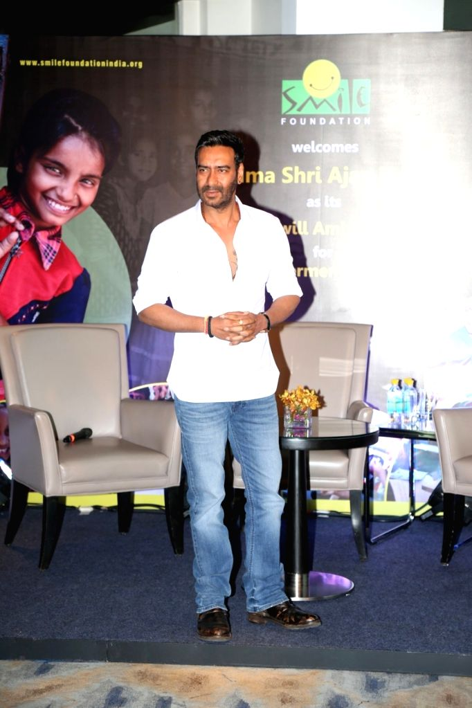 """Actor Ajay Devgn during the press conference of Smile Foundation to announce new campaign, """"She Can Fly"""", in Mumbai, on Sep 28, 2016. Ajay Devgn who has been associated with the ... - Ajay Devgn"""