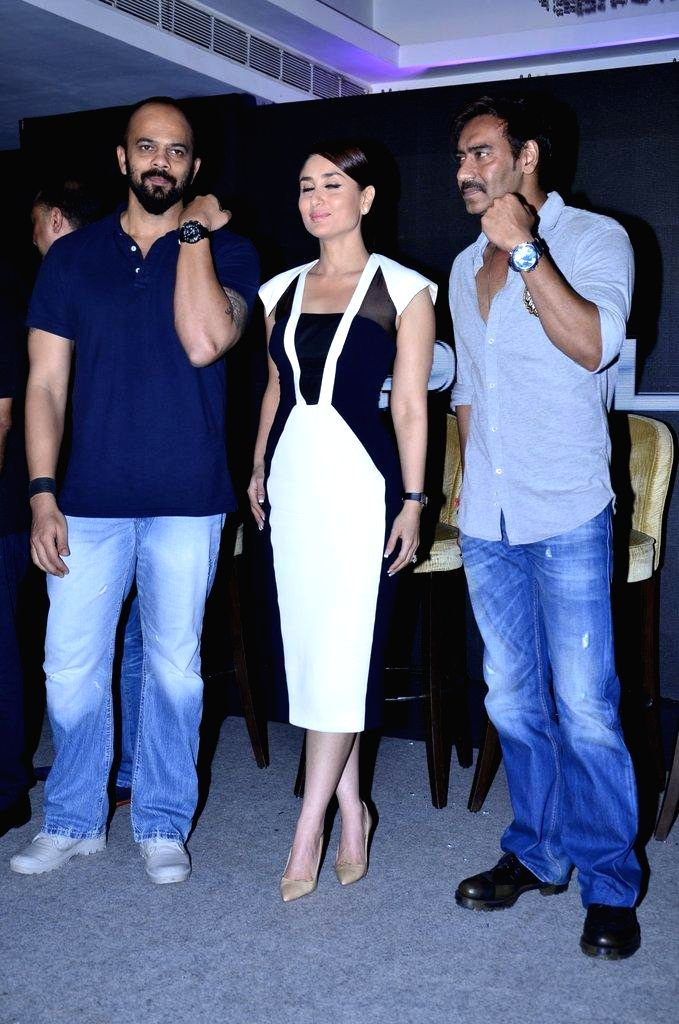 Actor Ajay Devgn, filmmaker Rohit Shetty and actor Kareena Kapoor during the launch of Singham time wear collection by Police in Mumbai, on August 9, 2014. - Ajay Devgn, Rohit Shetty and Kareena Kapoor