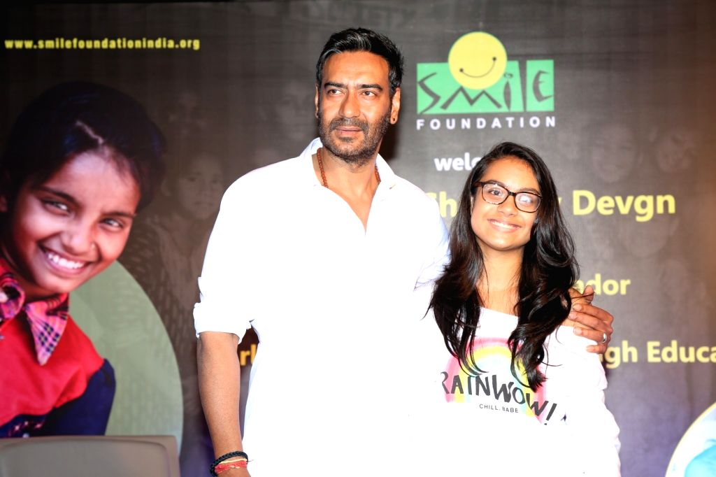 """Actor Ajay Devgn with his daughter Nysa during the press conference of Smile Foundation to announce new campaign, """"She Can Fly"""", in Mumbai, on Sep 28, 2016. Ajay Devgn who has been ... - Ajay Devgn"""