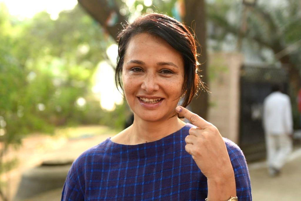 Actor Akkineni Nagarjuna's wife Amala Akkineni shows her inked finger after casting her vote for Telangana Assembly elections in Hyderabad on Dec 7, 2018. - Akkineni Nagarjun