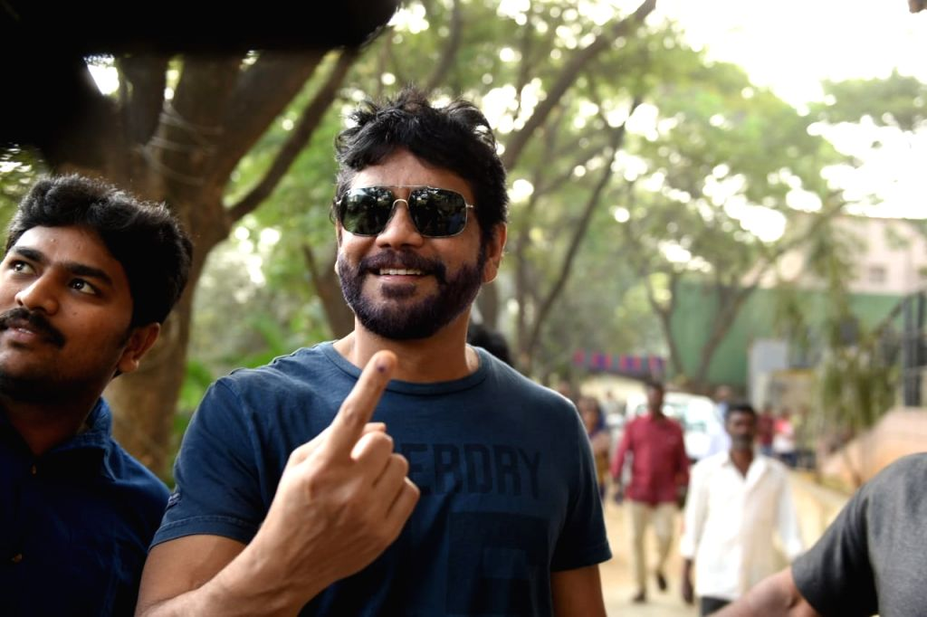 Actor Akkineni Nagarjuna shows his inked finger after casting his vote for Telangana Assembly elections in Hyderabad on Dec 7, 2018. - Akkineni Nagarjuna